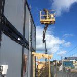 Aidan operating scissor lift, Wiri, Auckland